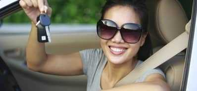 girl with credit default picking up new car